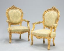 A PAIR LOUIS XV STYLE GILDED AND UPHOLSTERED FAUTEUILS