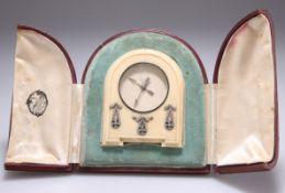 AN EARLY 20TH CENTURY FRENCH DIAMOND-SET IVORY STRUT CLOCK