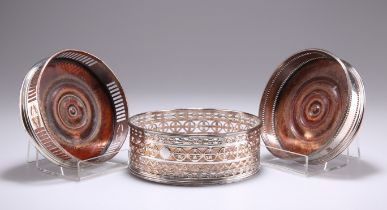 A GROUP OF THREE OLD SHEFFIELD PLATE WINE COASTERS, CIRCA 1800