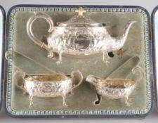 A VICTORIAN SILVER THREE-PIECE TEA SERVICE