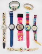 A GROUP OF EIGHT ASSORTED SWATCH WATCHES