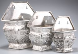 THREE UNMARKED WHITE-METAL WALL POCKETS