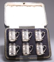 A SET OF SIX GEORGE V SILVER TOT CUPS
