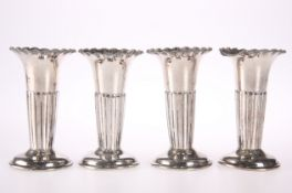 A SET OF FOUR PART FLUTED POSY VASES
