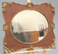 A PARCEL-GILT OAK MIRROR, 19TH CENTURY