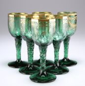 A RARE SET OF SIX BOHEMIAN GREEN AND GILDED WINE GLASSES, CIRCA 1790