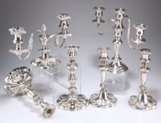 A GROUP OF SILVER-PLATED CANDLESTICKS AND CANDELABRA
