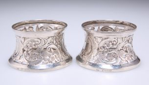A PAIR OF VICTORIAN SILVER NOVELTY NAPKIN RINGS
