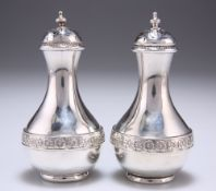 A PAIR OF VICTORIAN SILVER PEPPERS