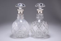 A PAIR OF ELIZABETH II SILVER-COLLARED DECANTERS