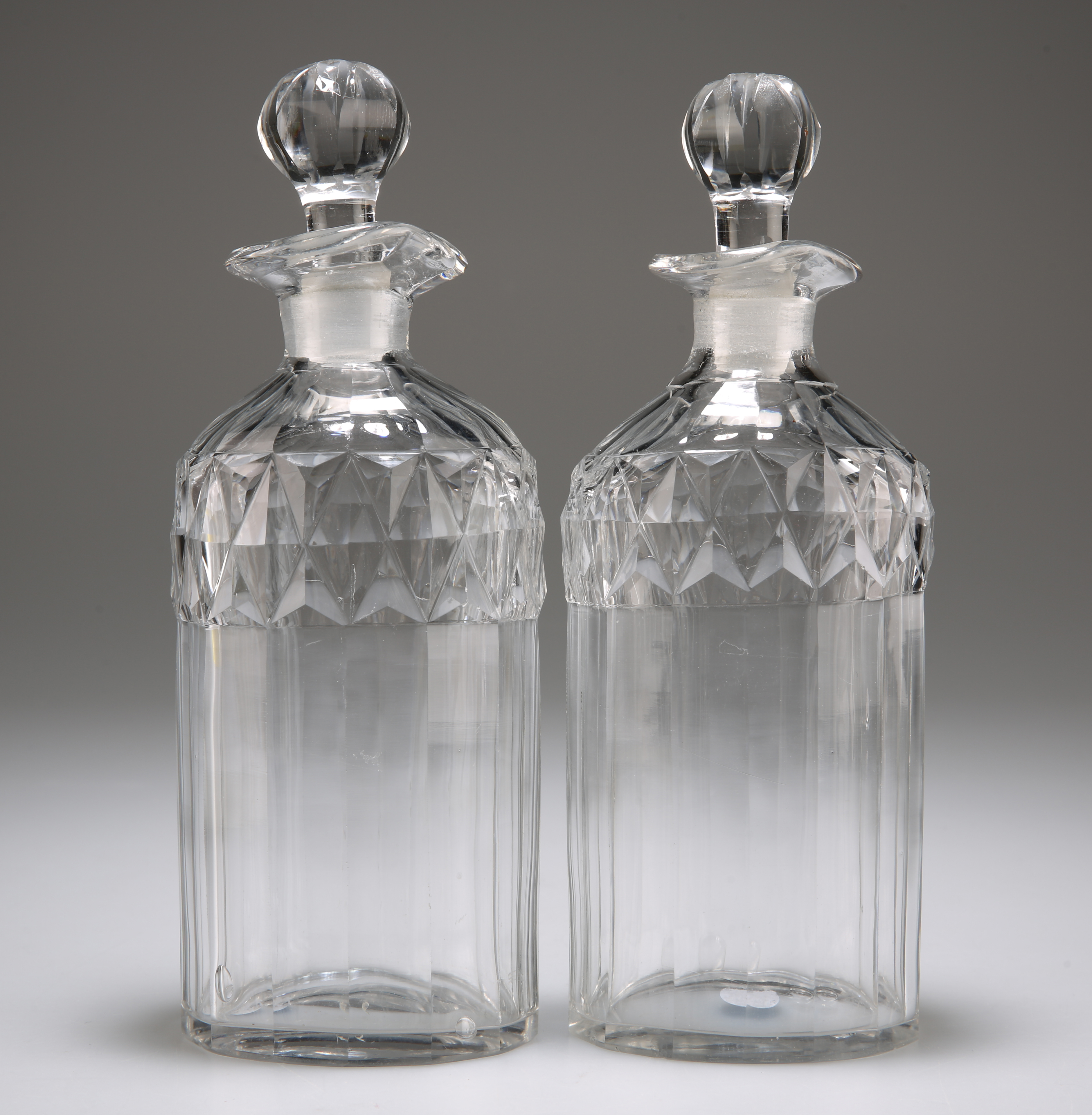 A PAIR OF GLASS SPIRIT DECANTERS WITH STOPPERS, CIRCA 1880