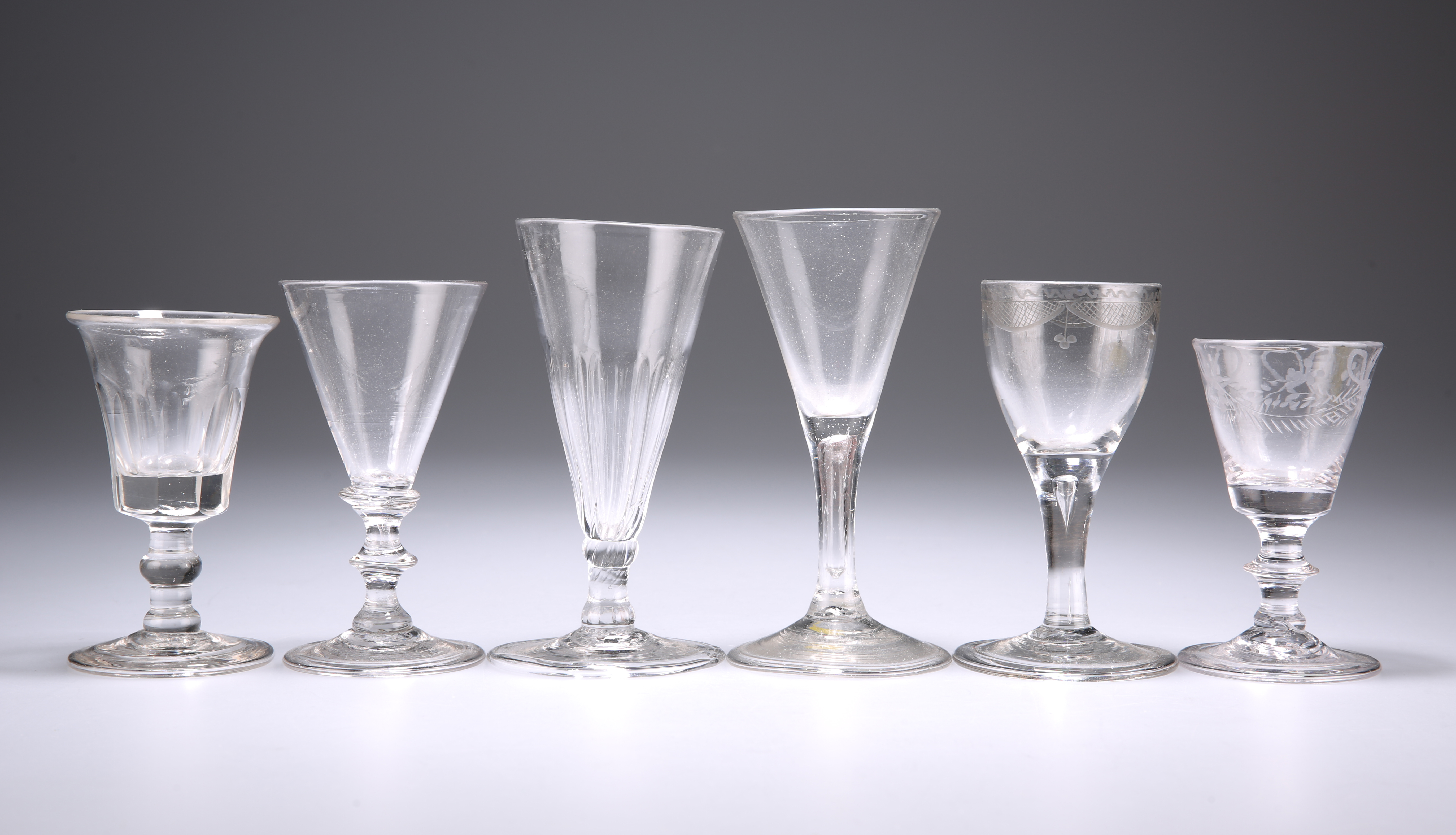 A GROUP OF SIX 18TH CENTURY DRINKING GLASSES