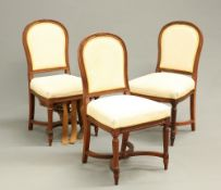 THREE MAHOGANY AND UPHOLSTERED CHAIRS FROM THE DINING SALOON OF R.M.S. MAJESTIC