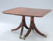A GEORGE III STYLE MAHOGANY TWIN PEDESTAL DINING TABLE