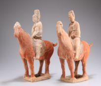 TWO CHINESE POTTERY HORSES AND RIDERS