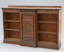 AN AESTHETIC MOVEMENT PARTIALLY EBONISED OAK BOOKCASE