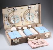 A MID 20TH CENTURY BREXTON PICNIC BASKET SET FOR FOUR PERSONS