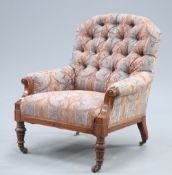 A VICTORIAN WALNUT AND UPHOLSTERED ARMCHAIR
