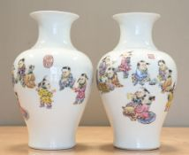 A PAIR OF CHINESE FAMILLE ROSE PORCELAIN 'BOYS' VASES
