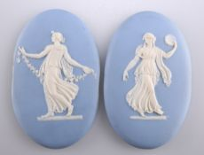 A PAIR OF 19TH CENTURY WEDGWOOD BLUE JASPER PLAQUES
