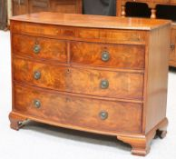 A 19TH CENTURY MAHOGANY BOW-FRONT CHEST OF DRAWERS