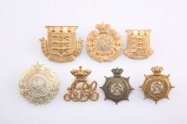 SEVEN VICTORIAN PERIOD OTHER RANKS' PATTERN CAP BADGES