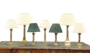 A GROUP OF SEVEN COUNTRY HOUSE BRASS COLUMNAR TABLE LAMPS