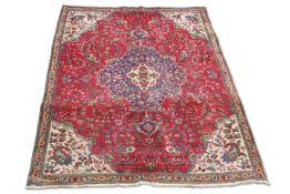 A PERSIAN TABRIZ CARPET