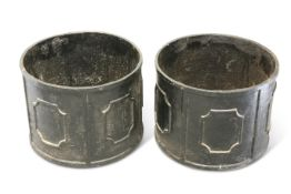 A PAIR OF CAST IRON CIRCULAR PLANTERS