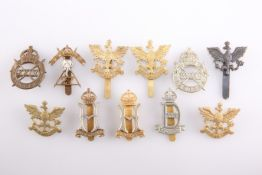 TEN CAP BADGES OF WW2 RAISED CAVALRY REGIMENTS