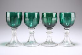 A SET OF FOUR EARLY 19TH CENTURY BRISTOL GREEN GLASS WINES