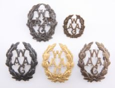 FOUR VARIANT BADGES OF THE WAAF, AND A COLLAR BADGE