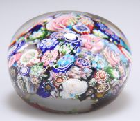 A SIGNED CLICHY CLOSE-PACKED MILLEFIORI PAPERWEIGHT, CIRCA 1850