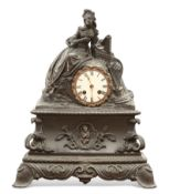 A FRENCH 19TH CENTURY PATINATED BRONZE MANTEL CLOCK