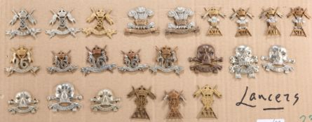 A COLLECTION OF CAP BADGES, COLLAR BADGES AND ARM BADGES