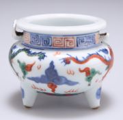 A SMALL CHINESE DOUCAI PORCELAIN TRIPOD CENSER