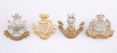 FOUR VICTORIAN PERIOD OTHER RANKS' PATTERN CAP BADGES