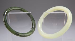 A CHINESE NEPHRITE JADE BANGLE, together with ANOTHER BANGLE