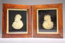 A PAIR OF EARLY 19TH CENTURY WAX PROFILE PORTRAITS