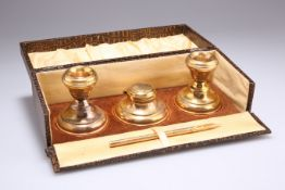 A PAIR OF GEORGE V SILVER-GILT CANDLESTICKS AND INKWELL