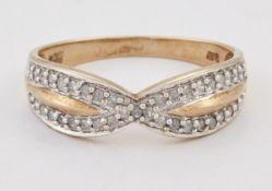 A 9 CARAT GOLD DIAMOND RING