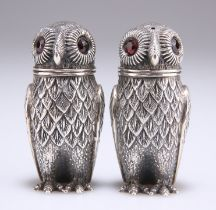A PAIR OF WHITE METAL NOVELTY PEPPER POTS
