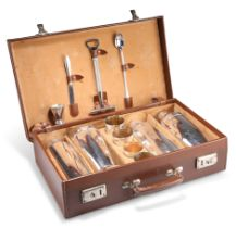 A VINTAGE LEATHER-CASED SILVER-PLATED TRAVELLING COCKTAIL SET