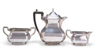 A GEORGE V SILVER THREE-PIECE TEA SERVICE