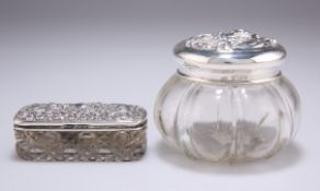 AN EDWARDIAN SILVER-TOPPED GLASS DRESSING TABLE JAR