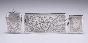 A GEORGE V SILVER CARD CASE, AND TWO SILVER VESTAS