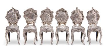 A SET OF SIX GERMAN SILVER MINIATURE CHAIRS