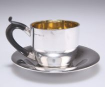 AN EDWARDIAN SILVER CUP AND SAUCER