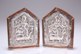 A PAIR OF 19TH CENTURY MIDDLE EASTERN SILVER PLAQUES