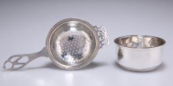A GEORGE V SILVER TEA STRAINER ON STAND